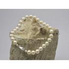 Parelarmband met ronde wite zoetwaterparels 6-6,5mm, luxe zilveren slot